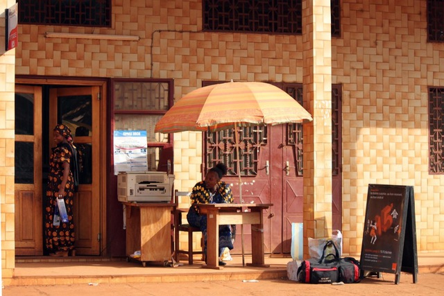 A women-run mini office with a printer and mobile phones, in Bafoussam, Cameroon, 12 January 2011