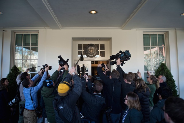 Members of the press follow Counselor to US President Donald Trump Kellyanne Conway while she speaks about a potential government shutdown outside the West Wing of the White House in Washington, DC, 19 January 2018