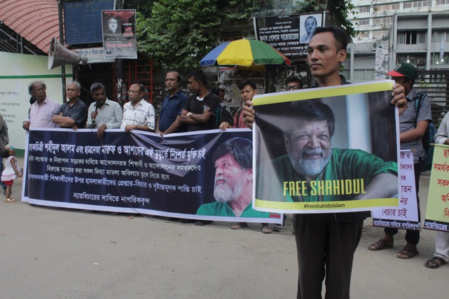 Protesters form a human chain to call for the release of photographer Shahidul Alam, in front of the National Press Club, in Dhaka, Bangladesh, 2 September 2018