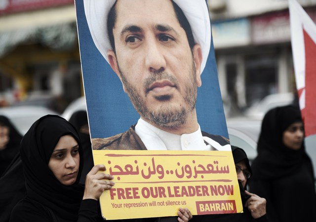 A Bahraini female protester holds a placard portraying Sheikh Ali Salman, head of the Shiite opposition movement Al-Wefaq, on March 24, 2015, during a demonstration against his arrest, in the village of Daih, west of Manama. Salman is behind bars for allegedly trying to overthrow the regime. His arrest on December 28, 2014, shortly after he was re-elected head of Bahrain's main opposition party Al-Wefaq, has sparked near-daily protests in Shiite villages.