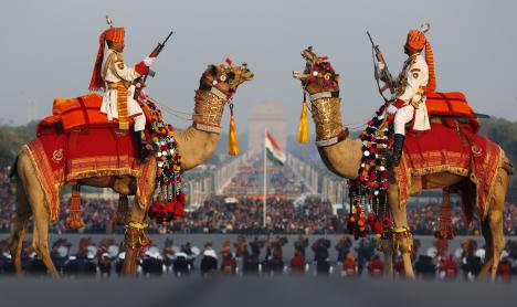 India's Border Security Force (BSF) soldiers rehearse for a ceremony in New Delhi, 27 January 2013