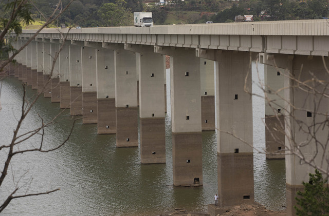 A bridge's columns show the previous water line over the Atibainha reservoir, part of the Cantareira System that provides water to the Sao Paulo metropolitan area