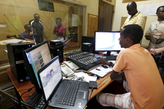 Senior staff at the Radio Publique Africaine work inside their broadcasting studio in Bujumbura, Burundi, 26 April 2015
