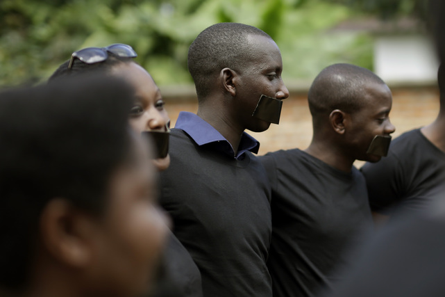 Journalists with tape on their mouths gather on the occasion of World Press Freedom Day, in Bujumbura, Burundi, 3 May 2015