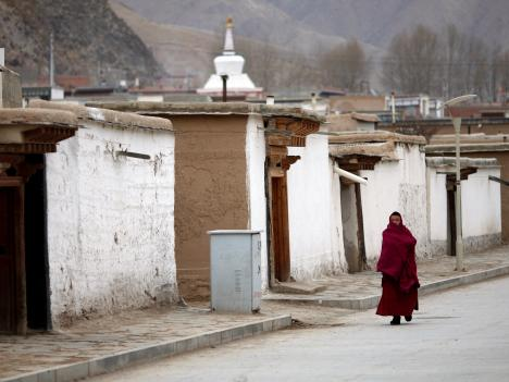 A Tibetan monk at Labrang Monastery in Gansu Province, 11 February 2013; China introduced a new system of information gathering to monitor monks and nuns in Tibetan monasteries in 2011