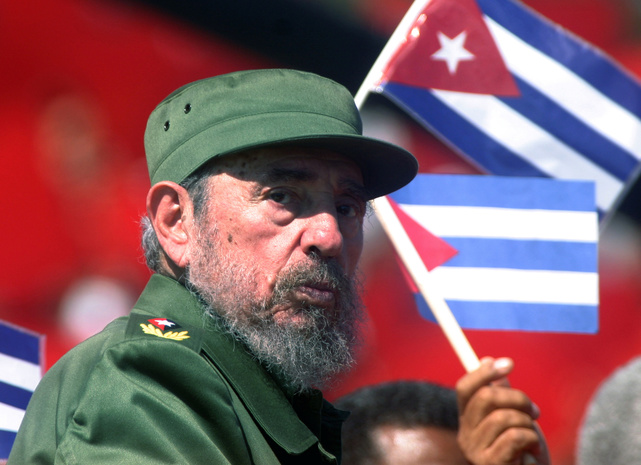 Then Cuban President Fidel Castro glances over his shoulder during the May Day commemoration in 2004