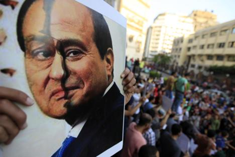 A poster show a placard with the faces of Egypt's ousted President Hosni Mubarak (L) and President Abdelfattah el-Sisi