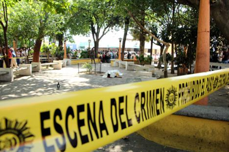 Crime scene tape in the central park of Mazatenango, Guatemala, where Federico Salazar and Danilo López were killed on 10 March 2015