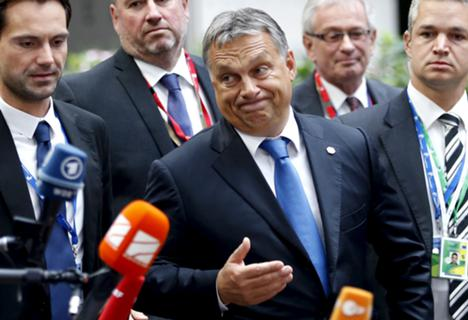Hungary's Prime Minister Viktor Orban reacts as he arrives at a European Union leaders extraordinary summit on the migrant crisis, in Brussels, 23 September 2015