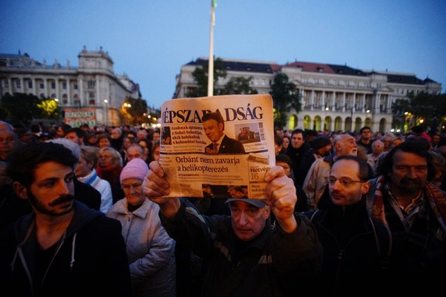 "A man shows the last printed edition of ""Népszabadság"" during a demonstration organised to express solidarity with Hungarian political daily in Budapest, Hungary, 8 October 2016."
