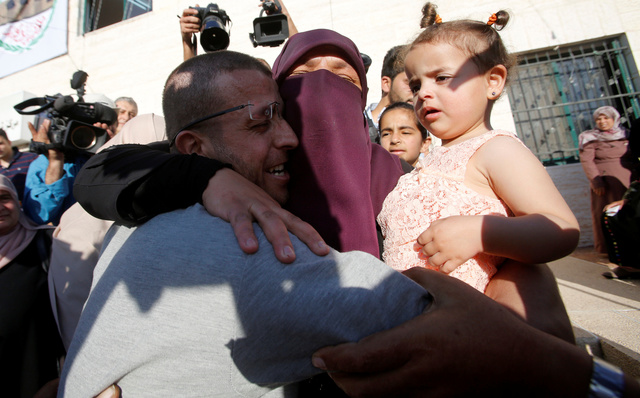 A May 2016 photo showing the Al Qiq being hugged by his sister in the West Bank town of Dura the day he was released. He has since been rearrested