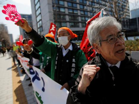Protesters at a rally against Japan participating in rule-making negotiations for the Trans-Pacific Partnership (TPP) in front of the parliament in Tokyo, 15 March 2013