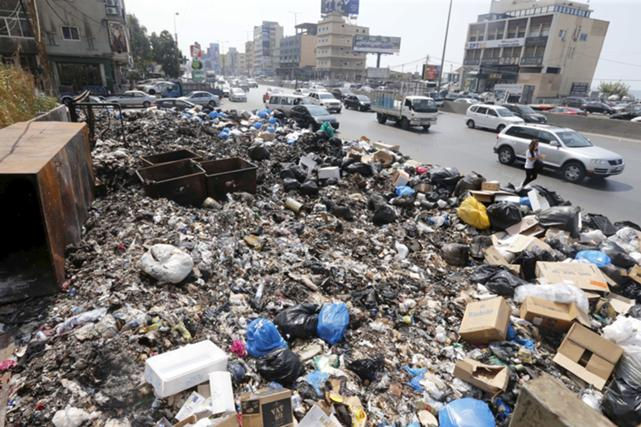 Garbage is piled along a highway in Beirut, Lebanon, September 3, 2015