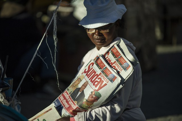 A newspaper seller is pictured on August 31, 2014 in Maseru, Lesotho
