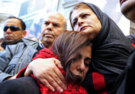 The mother (R) of photographer Nadhir Ktari, who disappeared with fellow journalist Sofiane Chourabi in Libya in September, attends a demonstration held in solidarity with the missing pair, in Tunis January 9, 2015