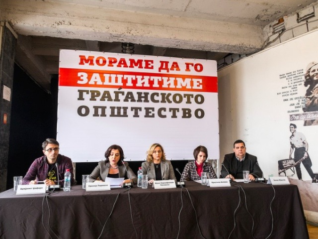 Civil society representatives hold a press conference in Skopje, 9 February 2017. The sign behind them reads,