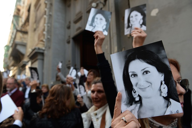 People leave the church of St Francis, after the Archbishop of Malta celebrated mass in memory of murdered journalist Daphne Caruana Galizia on the sixth month anniversary of her death in Valletta, 16 April 2018