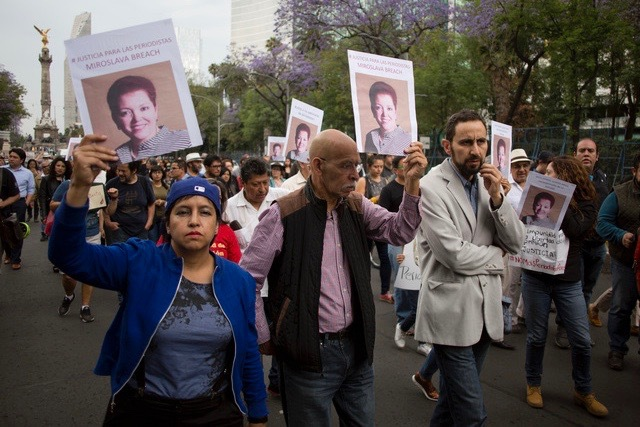 Protestors in Mexico City hold up signs demanding justice for slain journalist Miroslava Breach