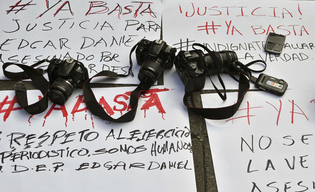 Cameras and messages of protest during a demonstration by photojournalists to demand justice for slain Mexican colleague Edgar Daniel Castro in San Luis Potosi, Mexico on October 6, 2017