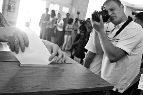 A journalist documents the municipal voting process in Chisinau, Moldova, June 2011.