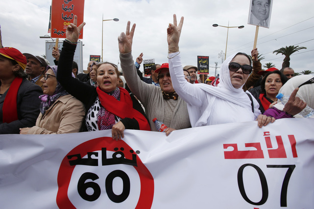 Protesters take part in a demonstration called by the Democratic Labor Organization (ODT) for better working conditions and retirement in Rabat, Morocco February 7, 2016. The sign reads,