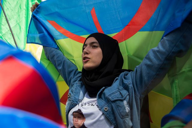 A protester from Rif movement Al-Hirak Al-Shaabi, or 'Popular Movement' waves the Amazigh flag, Rabat, Morocco, 2018