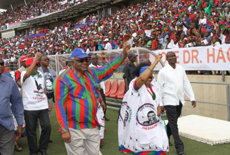 In this photo taken on 22 November 2014, Namibian president Hifikepunye Pohamba and his first lady, Penehupifo Pohamba arrive at the Sam Nujoma Stadium in Windhoek, Namibia for an election rally