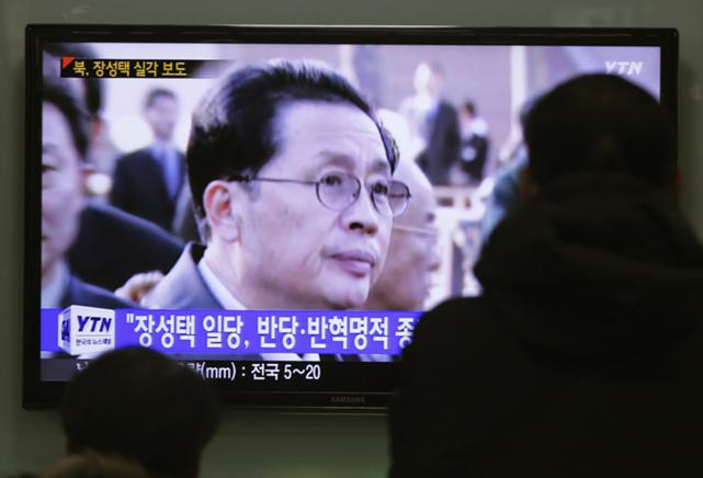People watch a TV news program showing North Korean leader Kim Jong Un's uncle, Jang Song Thaek, who was executed on 12 December. Hundreds of online articles mentioning him have been deleted