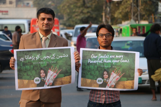 Education and peace activists hold signs on the streets of Peshawar, Pakistan, 24 February 2017