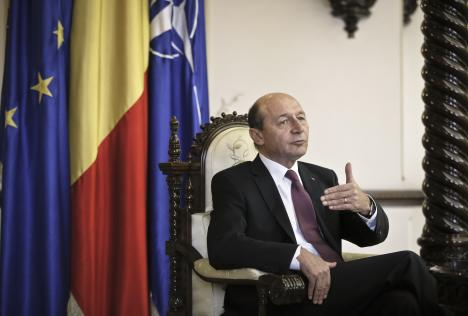 Romanian President Traian Basescu gestures during an interview with the Associated Press in Bucharest, Romania, 7 March 2013.
