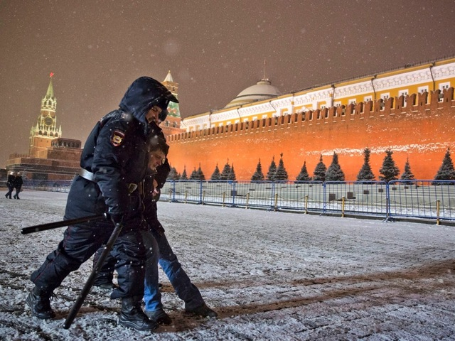 Police detain an LGBTQI+ activist in Red Square in Moscow, 7 February 2014