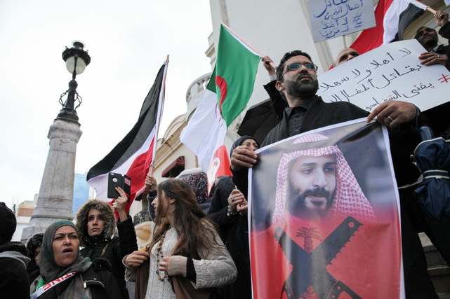 A protester holds a portrait of Mohammed bin Salman during a demonstration against the Saudi Crown Prince's visit to Tunisia, in Tunis, 27 November 2018