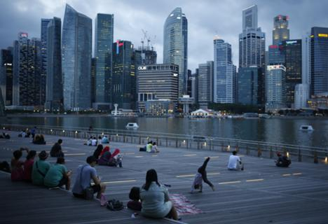 At Marina Bay overlooking the central business district in the evening in Singapore