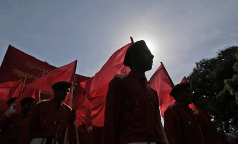 Activists of the Sri Lankan Marxist political party Peoples' Liberation Front march during a rally to mark International Labor Day in Colombo, Sri Lanka, 1 May 2015