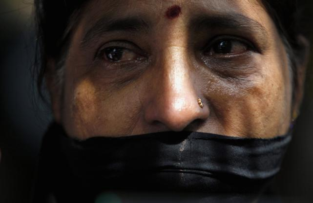 A Tamil woman takes part in a 24 January 2013 protest in Colombo to mark 3 years since the disappearance of journalist Prageeth Eknaligoda