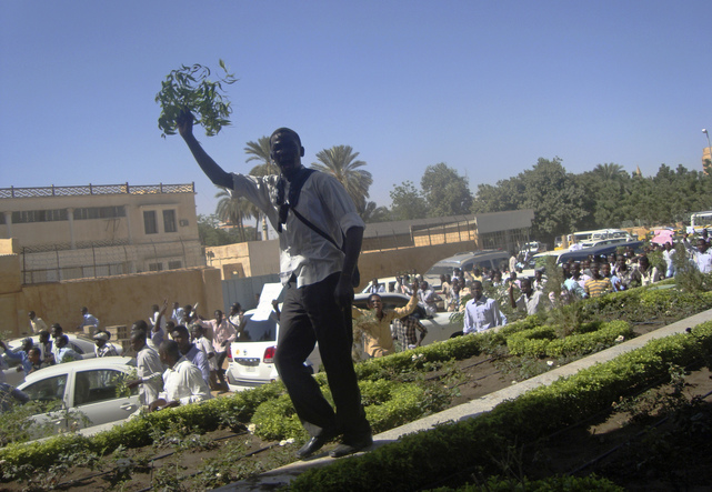 A student demonstrates outside the Ministry of Justice, over the deaths of four students from war-torn western region of Darfur in Gezira state, at Khartoum, 9 December 2012