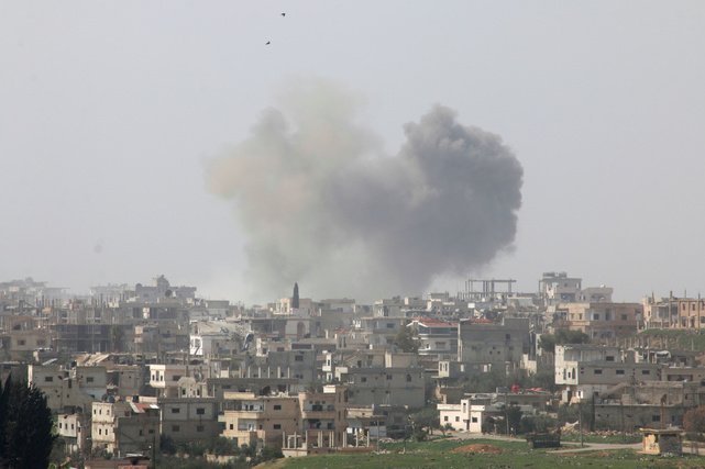 Smoke rises after strikes on rebel-held Deraa city, Syria March 10, 2017
