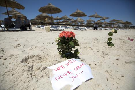 Flowers are laid at the beachside of the Imperial Marhaba resort, which was attacked by a gunman in Sousse, Tunisia, June 28, 2015