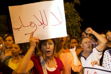People shout slogans during a protest to condemn an attack by a gunman at the beach of the Imperial Marhabada hotel in Sousse, Tunisia, June 27, 2015.