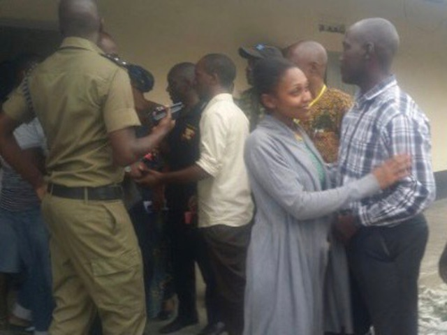 Joy Doreen Biira is received by relatives following her release from Kasese police station, in Western Uganda