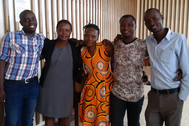 Journalists with an HRNJ-Uganda lawyer (2nd left) after the court had acquitted them
