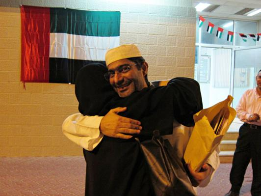 Human rights activists Ahmed Mansoor embracing his wife outside Al Wathba prison on November 28, 2011, after his prison sentence was commuted