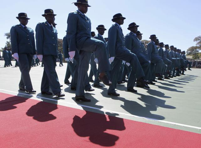 Police officers take part in a graduation ceremony for police recruits in Harare, 29 May 2014